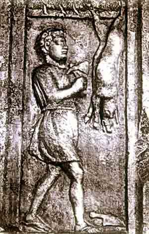 Macellaio che squarcia un maialetto: Rilievo parietale da Aquileia
